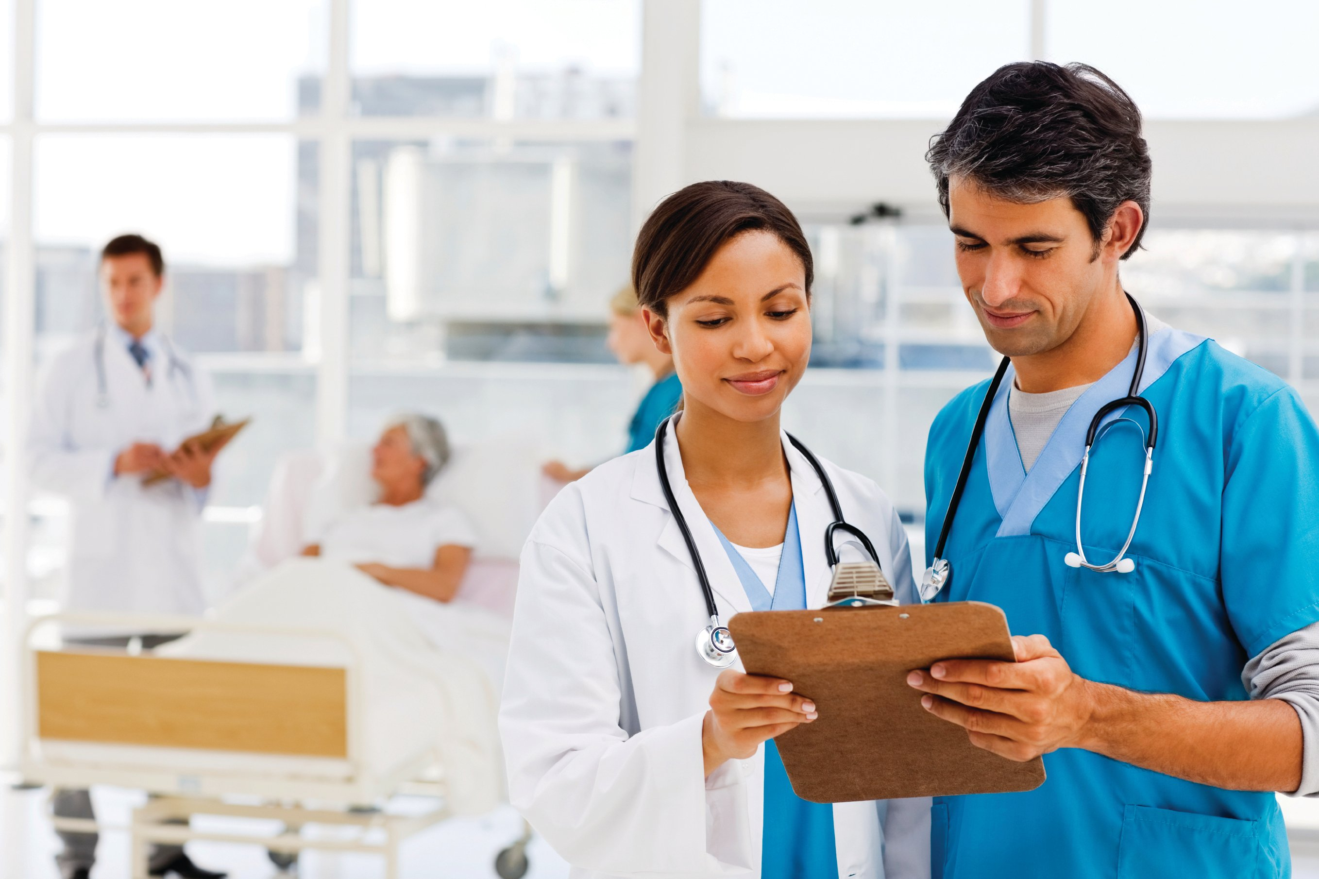 Two hospitalists look over a clipboard